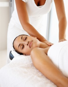 bigstockphoto_Cute_Woman_Receiving_A_Massage_5001745